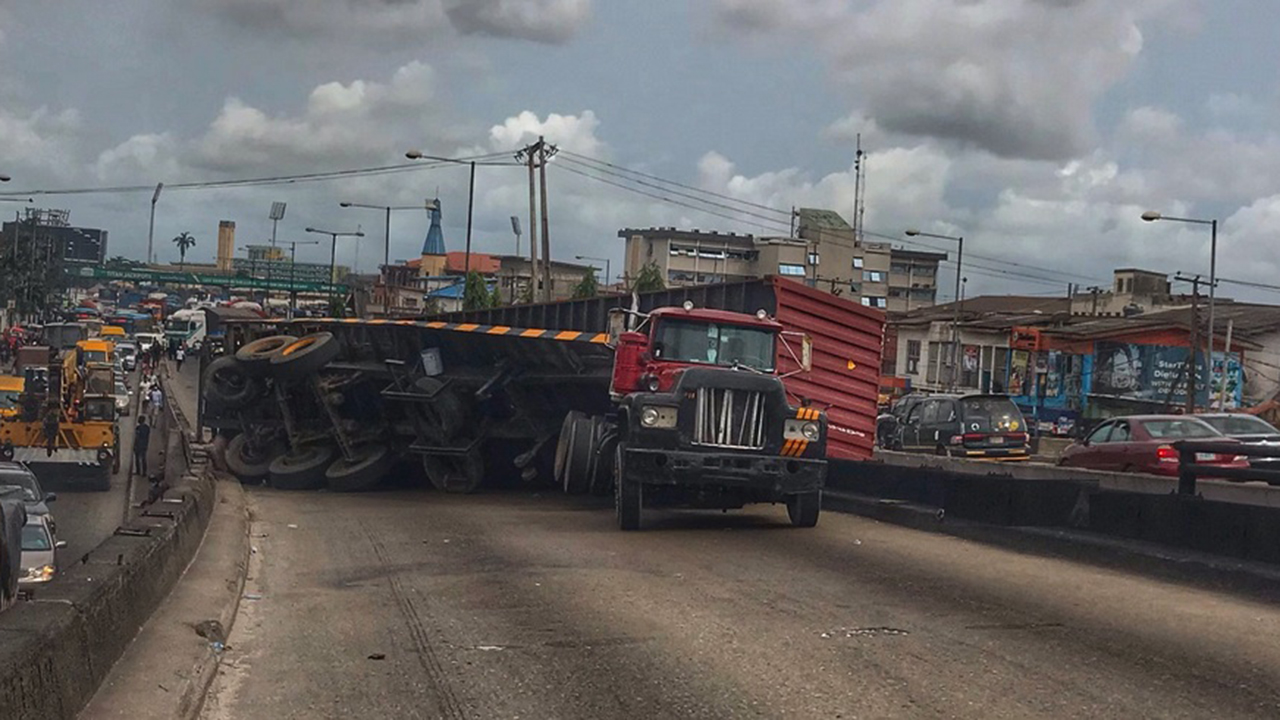 Lagos locked down as container falls on Ojuelegba bridge